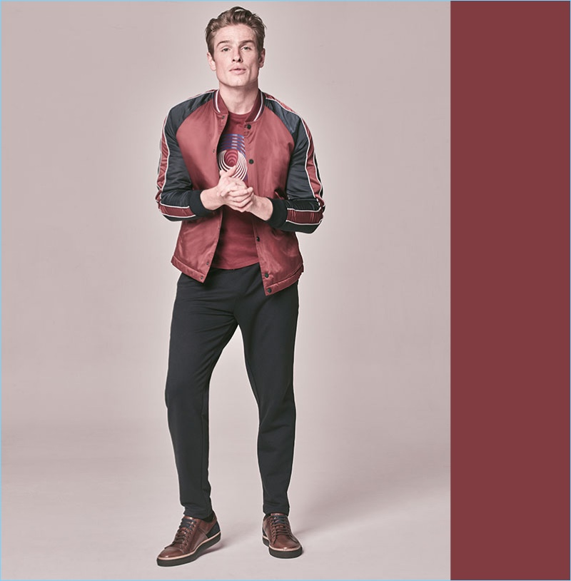 Ben Sherman is front and center for Macy's style edit. Model Patrick O'Donnell wears a Ben Sherman graphic t-shirt $35, color-blocked bomber jacket $149, and joggers $79.
