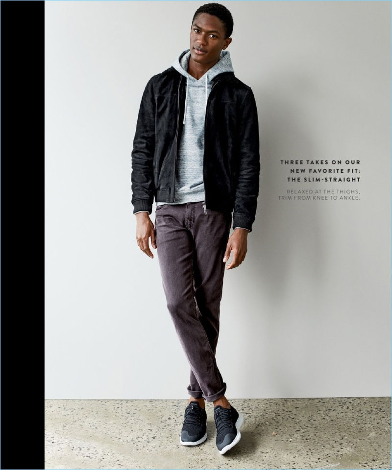 Tackling a slim-straight fit, Hamid Onifade wears Paige jeans $199 with a Ted Baker London suede jacket $819. The model also sports a Reigning Champ french terry hoodie $145 and Nike sneakers $110.