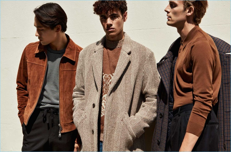 Brown: Make way for an earthy color palette this fall with a rich tapestry of brown. Left to Right: AMI slim-fit suede jacket, striped Maison Margiela sweater, and Acne Studios drawstring trousers. A.P.C. tweed virgin wool coat and jacquard knit wool sweater. Acne Studios wool-blend coat, Arpenteur double pleat trousers, and Prada wool polo shirt.
