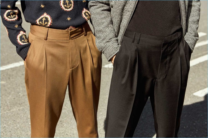 Mr Porter makes a case for pleated trousers with a brown pair from Kent & Curwen, alongside a black alternative by Prada. The models also sports a Gucci anchor print sweater, Officine Generale turtleneck, and Lanvin blouson jacket.