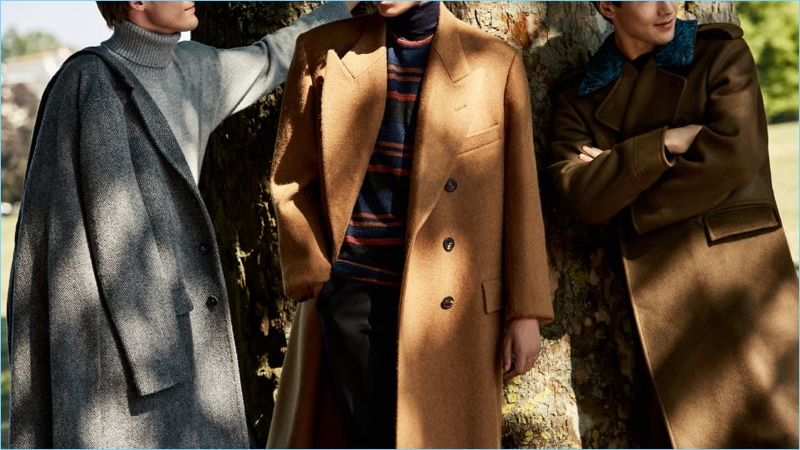 Make a sartorial impression in a tailored coat. Left to Right: Massimo Alba herringbone wool coat and Tomas Maier cashmere sweater. Dries Van Noten double-breasted coat, Lanvin striped sweater, and Canali trousers. Berluti double-breasted cashmere coat.