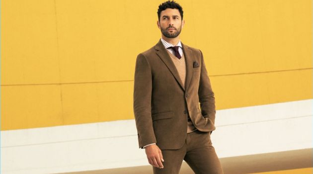 Posing against a yellow backdrop, Noah Mills stars in Pedro del Hierro's fall-winter 2017 campaign.
