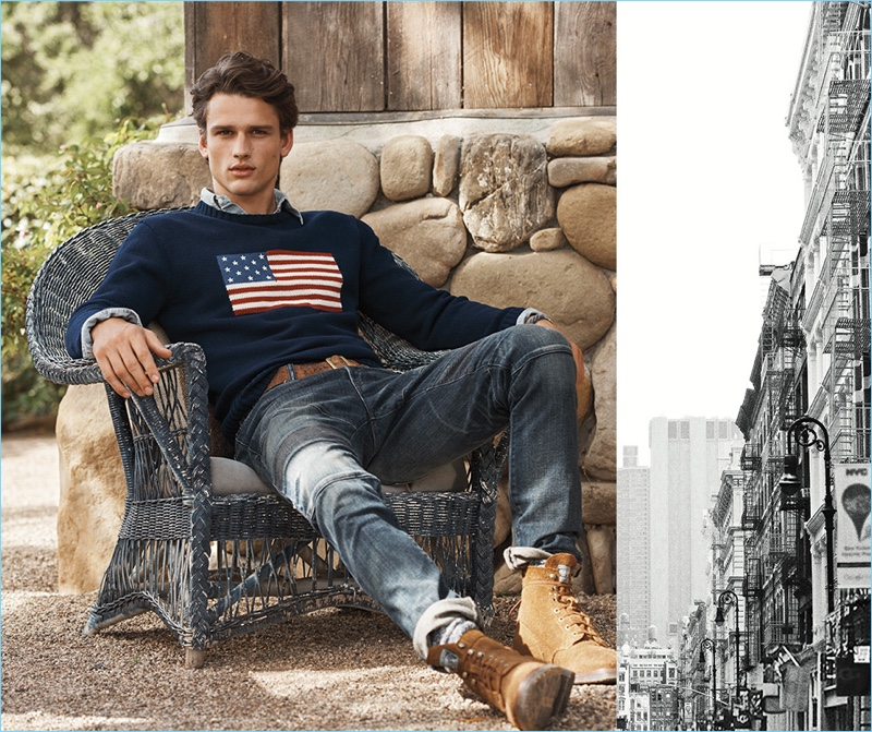 Simon Nessman relaxes in POLO Ralph Lauren's iconic flag sweater $225. He also wears the label's Sullivan slim stretch jeans $198.