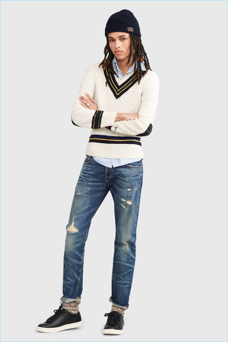 Offering a young spin on preppy, Don Lee wears POLO Ralph Lauren's iconic cricket sweater $295 with distressed denim jeans and a knit beanie.
