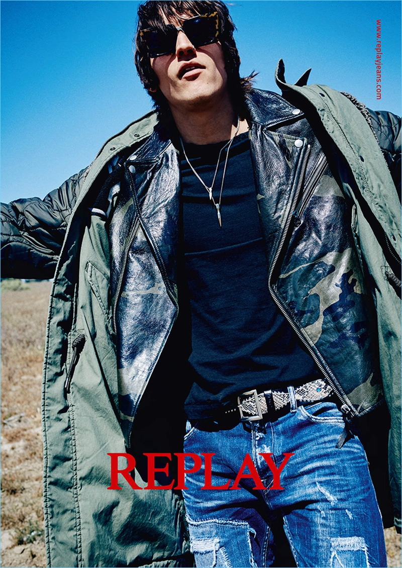 A cool vision, Leebo Freeman layers with a leather biker jacket and parka for Replay's fall-winter 2017 campaign.