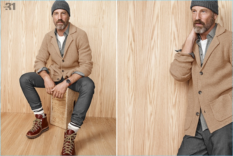 A rugged vision, Rainer Andreesen sports a camel colored cardigan with a knit beanie and hiking boots.