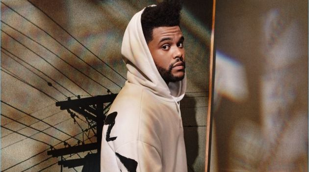 Reuniting with H&M, The Weeknd wears a white oversize hoodie $34.99.