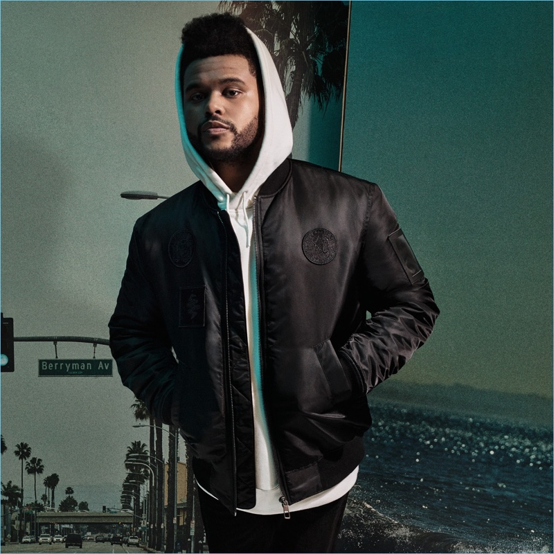 Making a case for sporty style, The Weeknd wears a bomber jacket $79.99 and oversize hoodie $34.99.