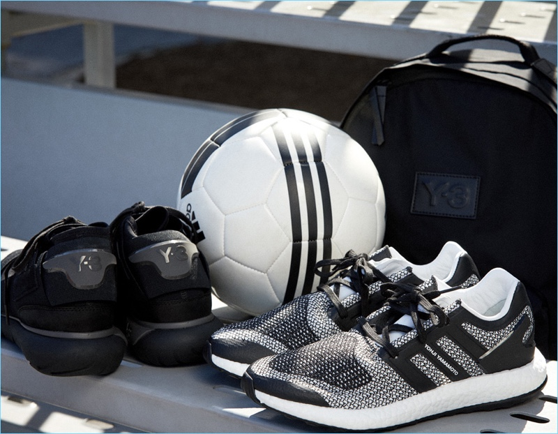 Update your sporty essentials with Y-3. Left to Right: Y-3 Qasa High sneakers $390, Pureboost sneakers $320, and Techlite backpack $220.