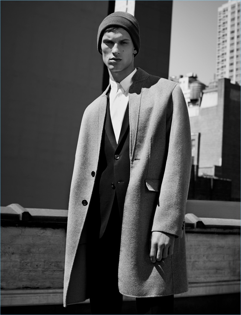 Connecting with Zara Man, David Trulik wears a sharp overcoat with a modern silhouette.