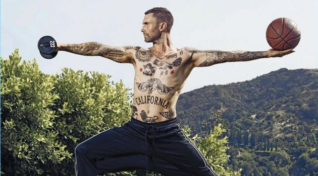 Working out, a shirtless Adam Levine appears in a photo shoot for Men's Fitness.