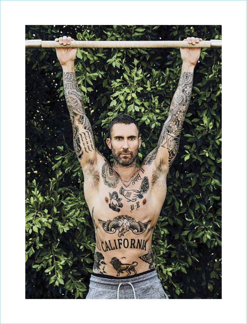 Showing off his tattoos, Adam Levine graces the pages of Men's Fitness.