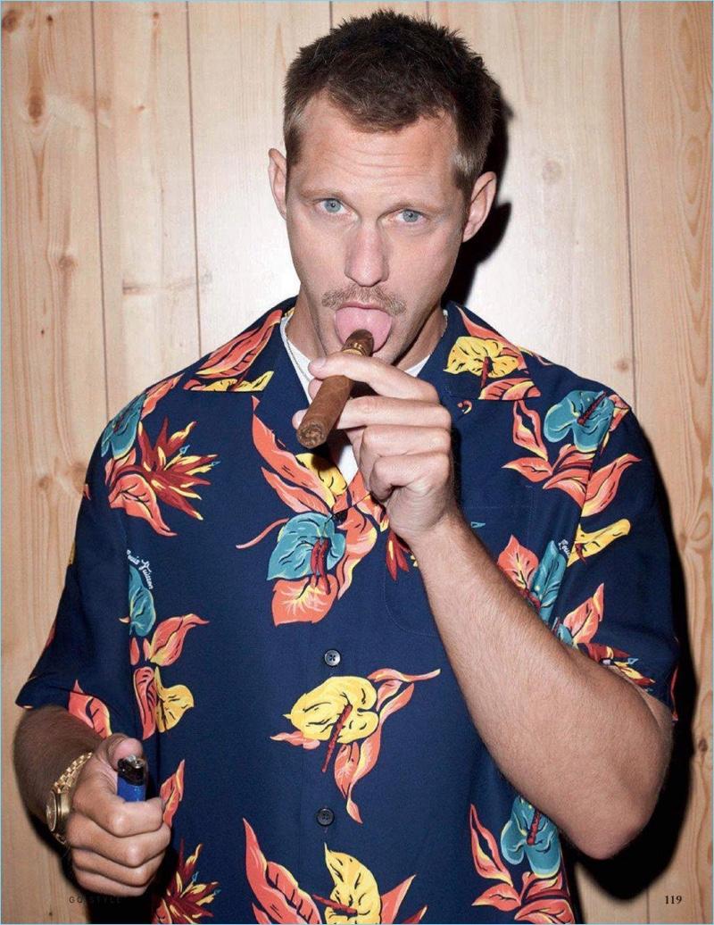 Actor Alexander Skarsgård wears a Louis Vuitton Hawaiian print shirt. He also sports a Sunspel t-shirt and Tom Ford sunglasses.