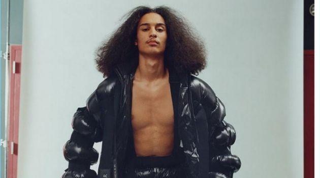 Taj Figueroa wears a puffer jacket and pants by Moncler.
