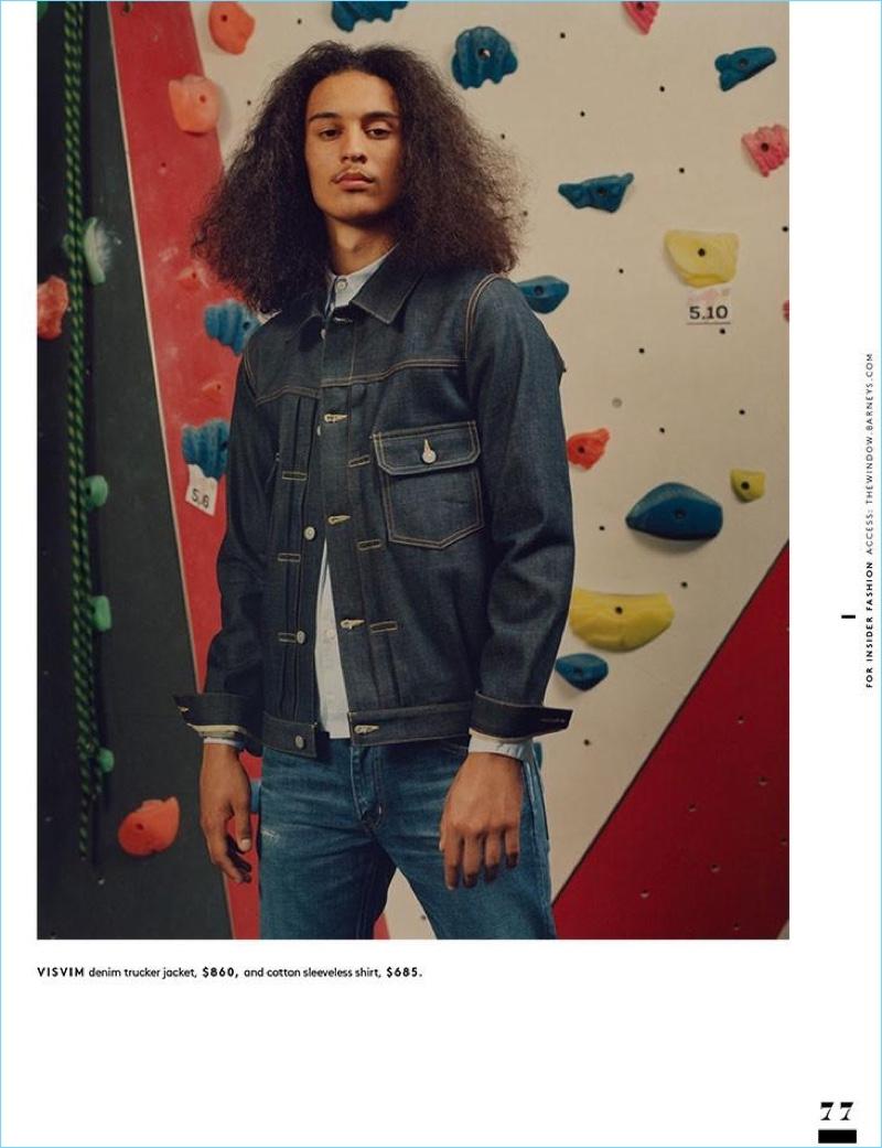 Doubling down on denim, Taj Figueroa wears a Visvim denim trucker jacket and sleeveless shirt.