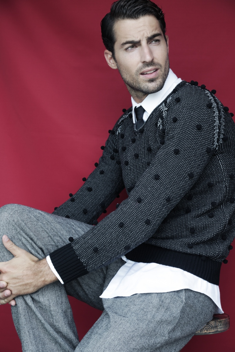 Antonio wears sweater Emporio Armani, shirt Marciano by GUESS, tie and trousers Antonio Miro.