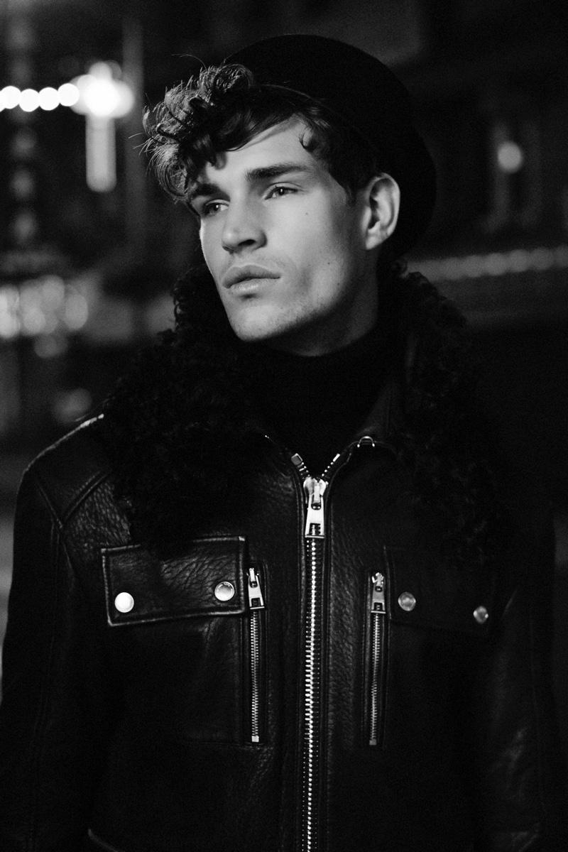 Louren wears turtleneck and leather jacket Michael Kors.