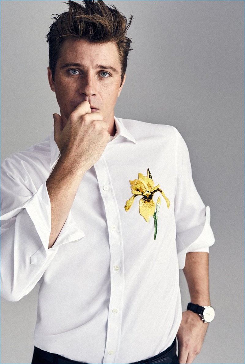Front and center, Garrett Hedlund wears an Alexander McQueen shirt, Prada trousers, and a Zenith watch.