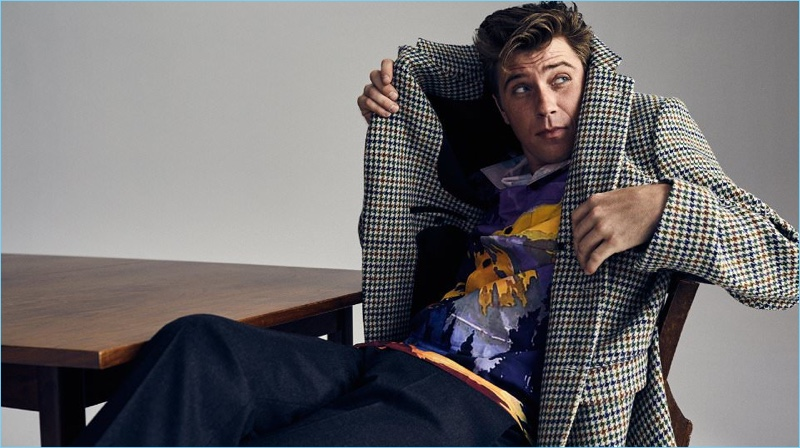 Posing for a cheeky image, Garrett Hedlund wears a Raf Simons houndstooth blazer with a Prada shirt and trousers.