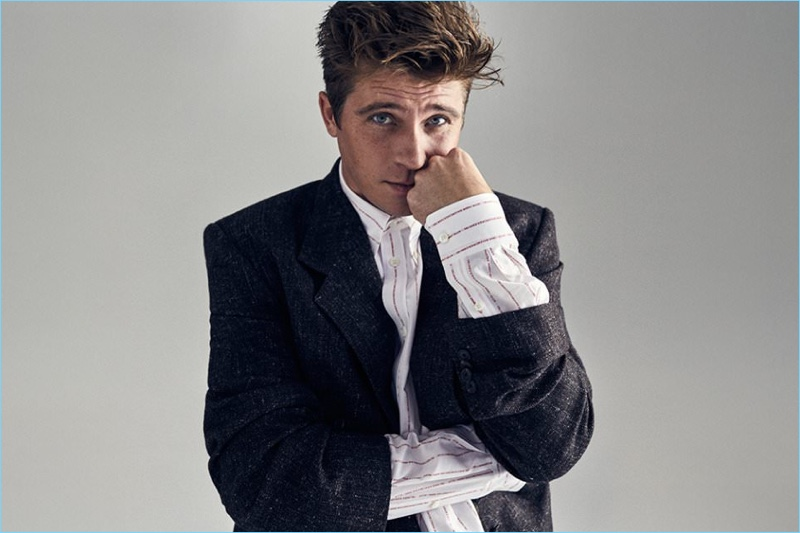 Actor Garrett Hedlund wears a Balenciaga tweed blazer and oversize button-down shirt.
