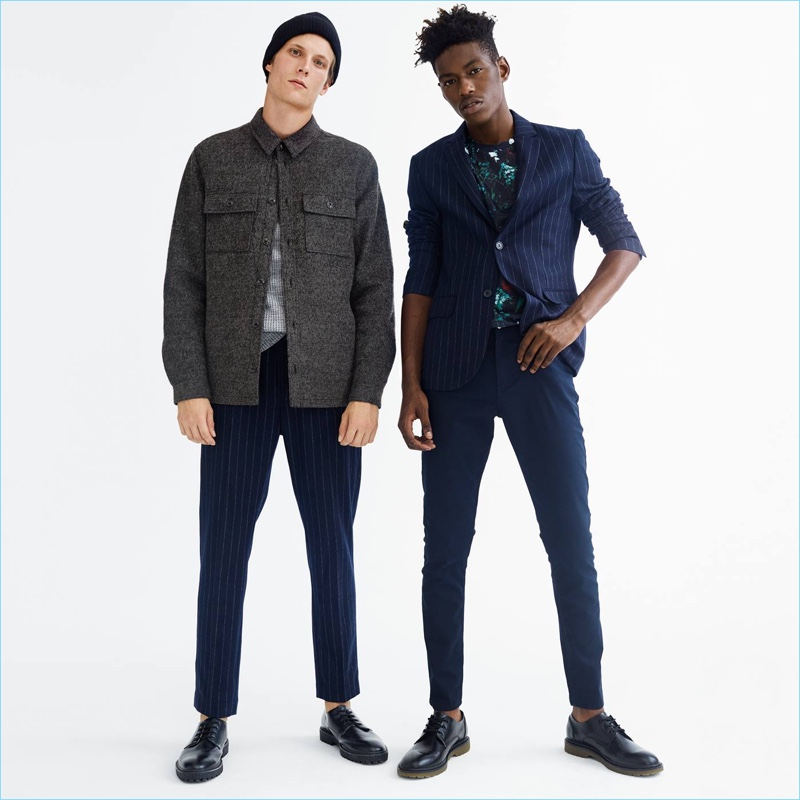 Left: Channeling workwear vibes, Felix Gesnouin wears a H&M wool-blend shirt jacket. The French model also sports a thermal sweater and pinstripe suit pants. A knit beanie and chunky-soled derby shoes complete his look. Right: Sheani Gist models a H&M pinstripe suit jacket with an all-over print t-shirt. Smart suit pants and dress shoes also make a sound impression.