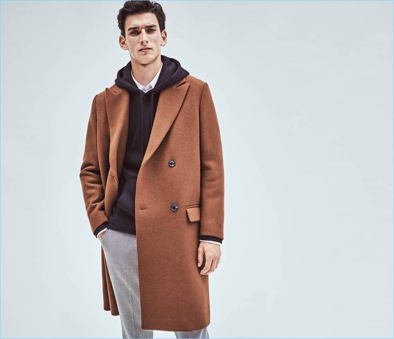 Ready for the cold weather, Thibaud Charon wears a brown H&M wool-blend coat $129.