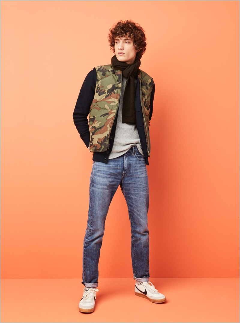 Embrace a rugged sporty aesthetic with J.Crew's Nordic camouflage down vest. Model Serge Rigvava wears it with a Wallace & Barnes bomber jacket and thermal tee. He also sports J.Crew's 1040 athletic jeans, a herringbone scarf, and Nike for J.Crew sneakers.