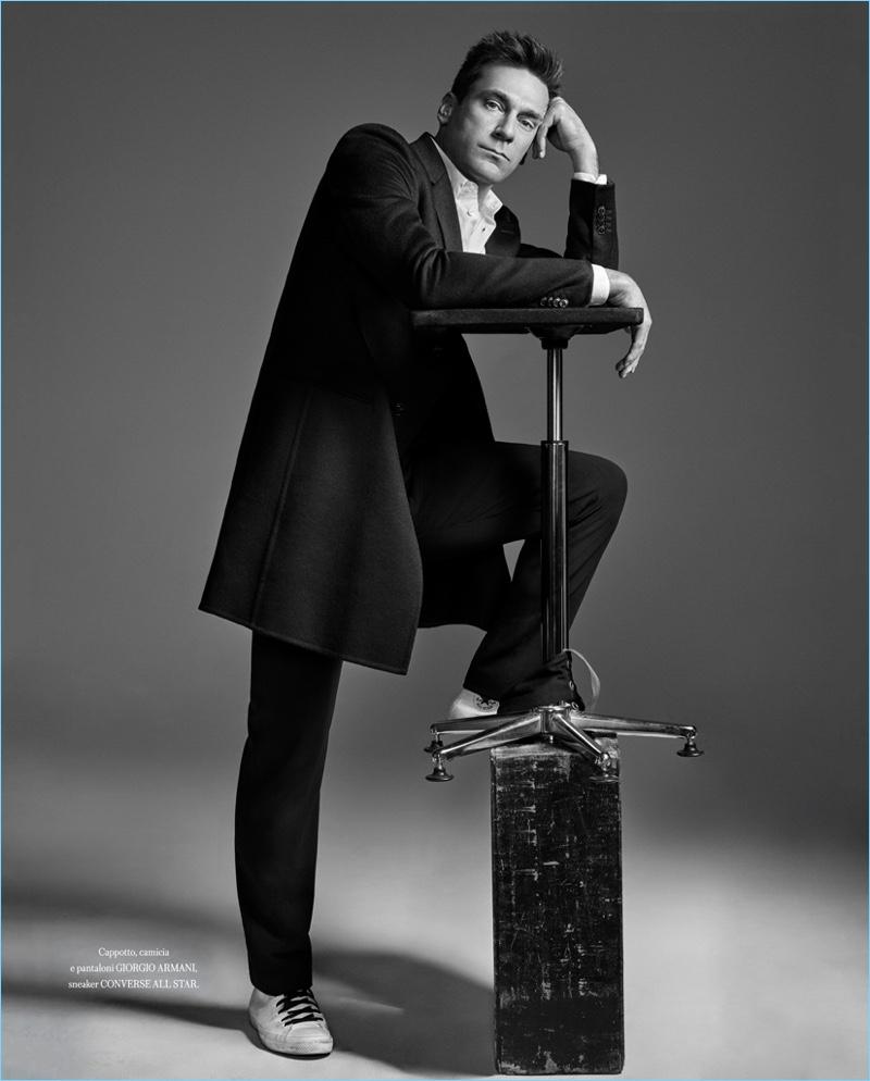 Taking to the studio, Jon Hamm wears a sharp Giorgio Armani look with Converse sneakers.