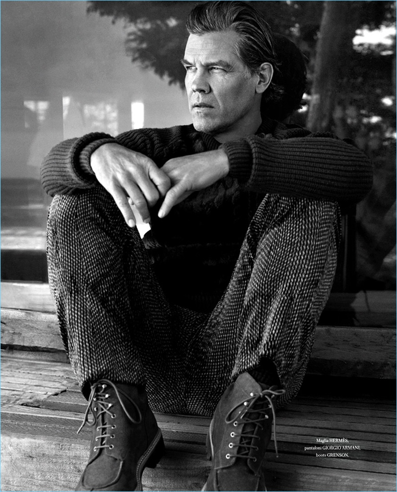 Appearing in a black and white image, Josh Brolin rocks a Hermès sweater with Giorgio Armani pants and Grenson boots.