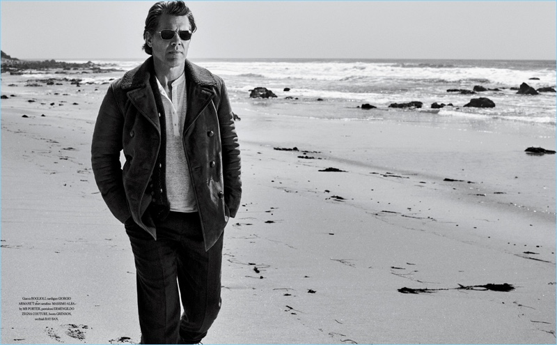 Taking to the beach, Josh Brolin wears a Boglioli jacket with a Giorgio Armani cardigan, and Massimo Alba t-shirt. His look is complete with Ermenegildo Zegna Couture pants and Ray-Ban sunglasses.