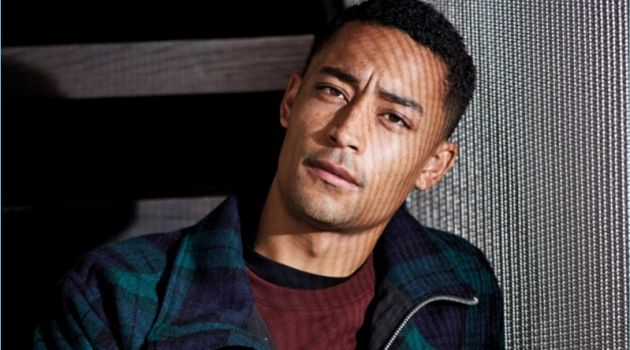 Connecting with Men's Health UK, Loyle Carner wears a check Oliver Spencer jacket with an A.P.C. sweatshirt. Carner also dons a Paul Smith t-shirt and Carhartt WIP trousers.