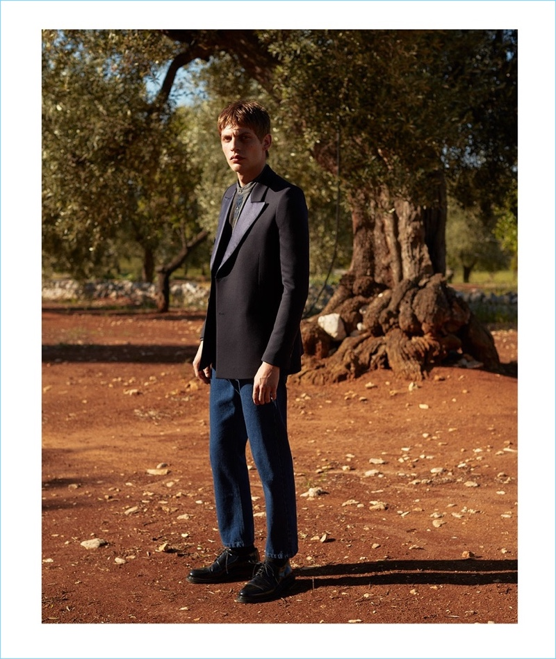 Connecting with Matches Fashion, Baptiste Radufe wears a Lanvin tuxedo jacket with a Helbers shirt and Raf Simons jeans. Baptiste's look also includes AMI shoes.