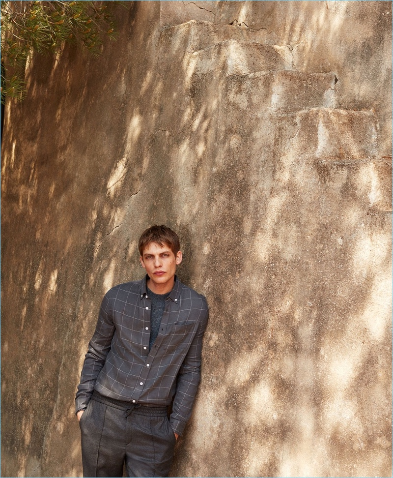 Clad in gray, Baptiste Radufe wears a Saturdays NYC shirt with a Valentino sweater and Brioni trousers.