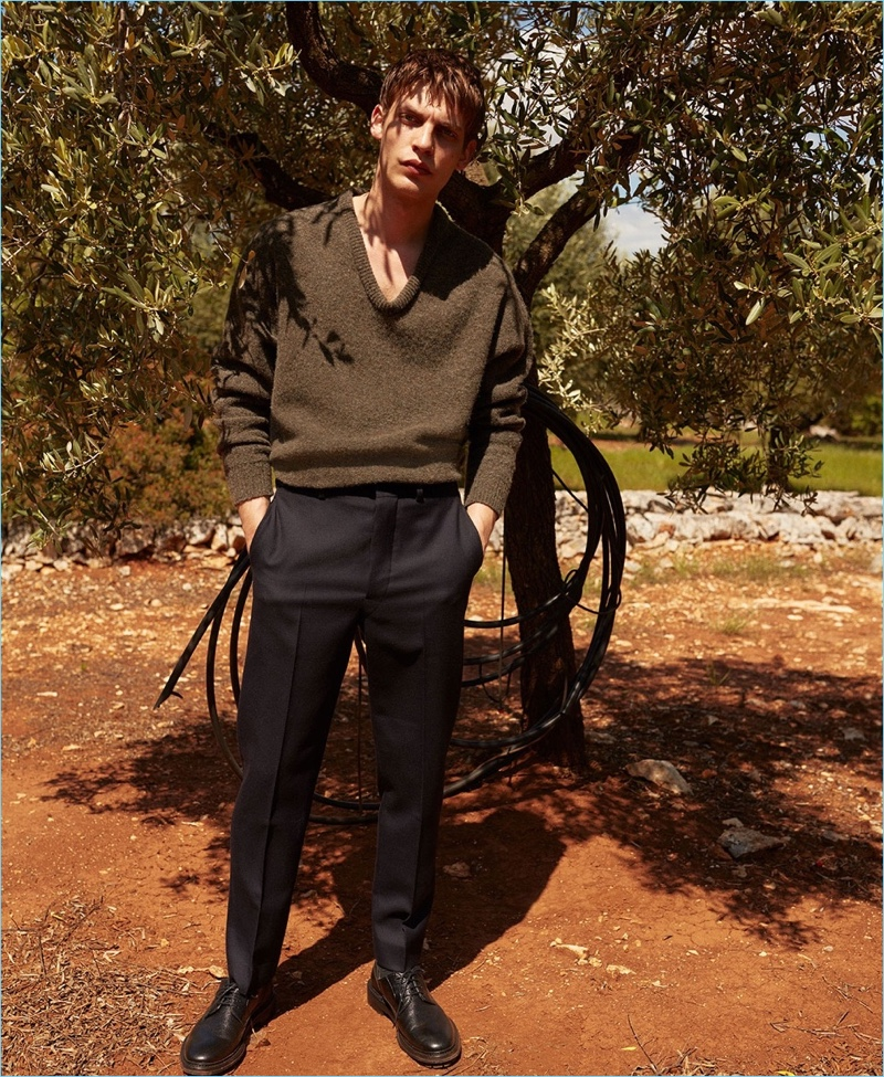 Showcasing smart style, Baptiste Radufe wears an oversize Lemaire sweater and trousers with Lanvin shoes.