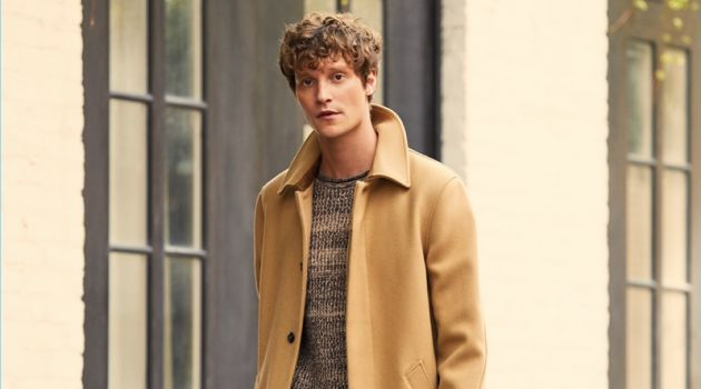 A.P.C. makes a classic camel statement with its Mac overcoat. East Dane complements the essential with a Tomorrowland sweater and trousers. Complete the look with a Cambridge Satchel folio.