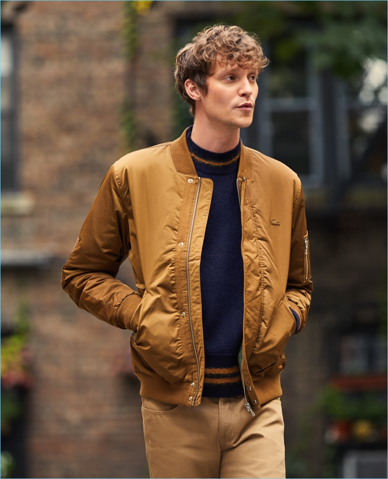 Camel gets sporty with this Lacoste padded bomber jacket. Reuniting with East Dane, Matthew Hitt wears the must-have with a Marni sweater and Naked & Famous jeans.