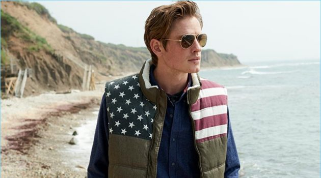 Connecting with Macy's, Patrick O'Donnell wears a flag quilted vest with Ray-Ban sunglasses.