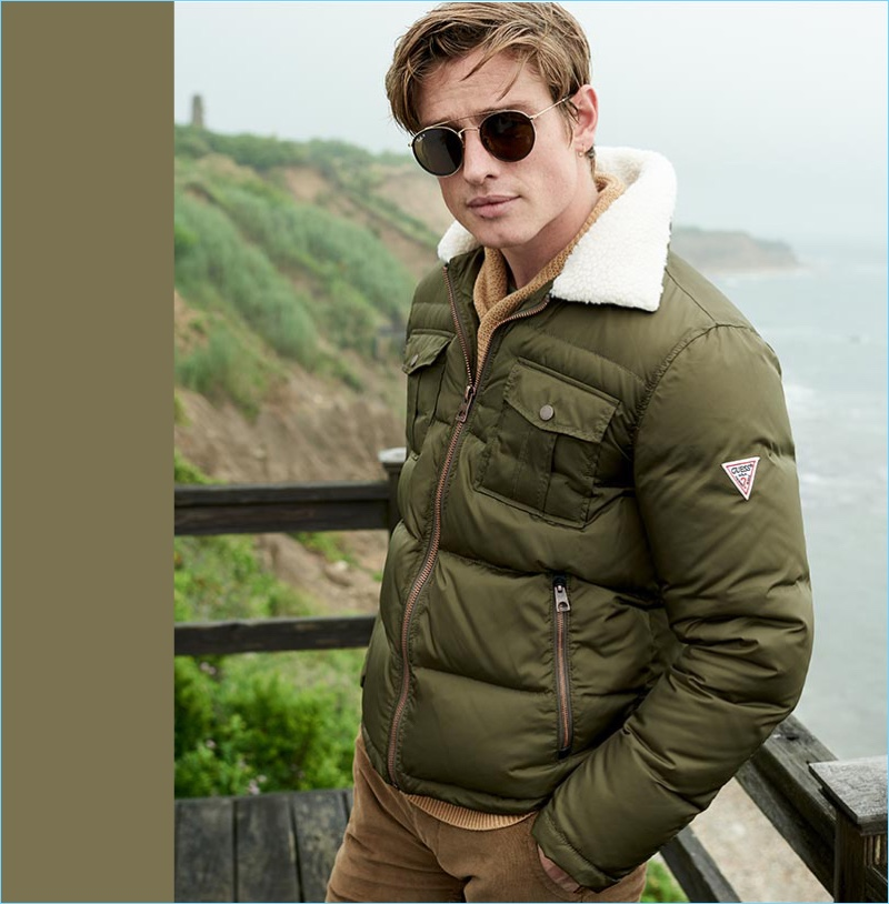 Tapping into military style, Patrick O'Donnell wears a GUESS quilted jacket with a fleece collar.