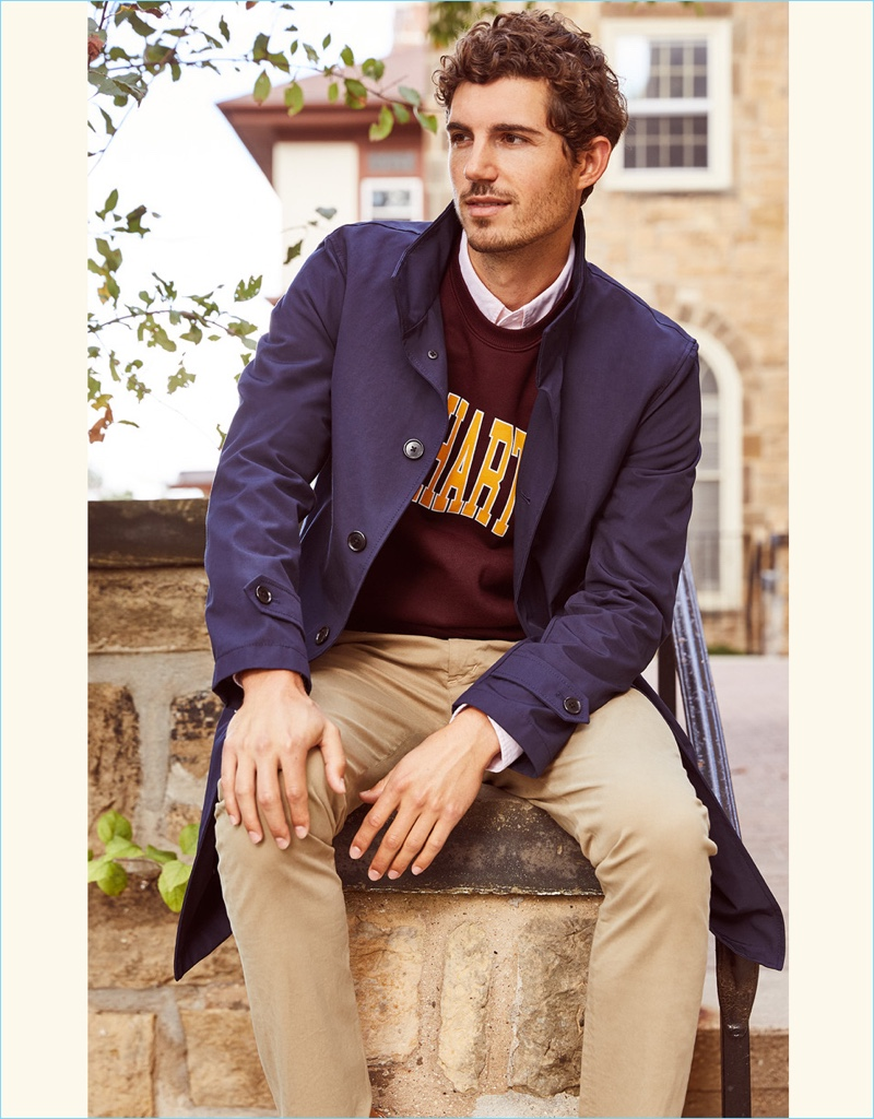 Classic Chinos: Relaxing, David Kitz wears a Club Monaco mac jacket and Citizens of Humanity skinny chinos. He also dons a Carhartt WIP sweatshirt.