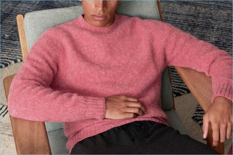 Add some color to your wardrobe with this pink Howlin sweater. Here, it's styled with Dries Van Noten wool-flannel trousers.