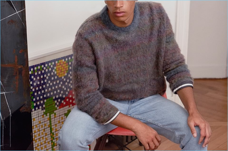 Nothing says cozy like this oversize mélange knit sweater by Acne Studios. A casual element is added with Stella McCartney denim jeans and a Margaret Howell striped t-shirt.