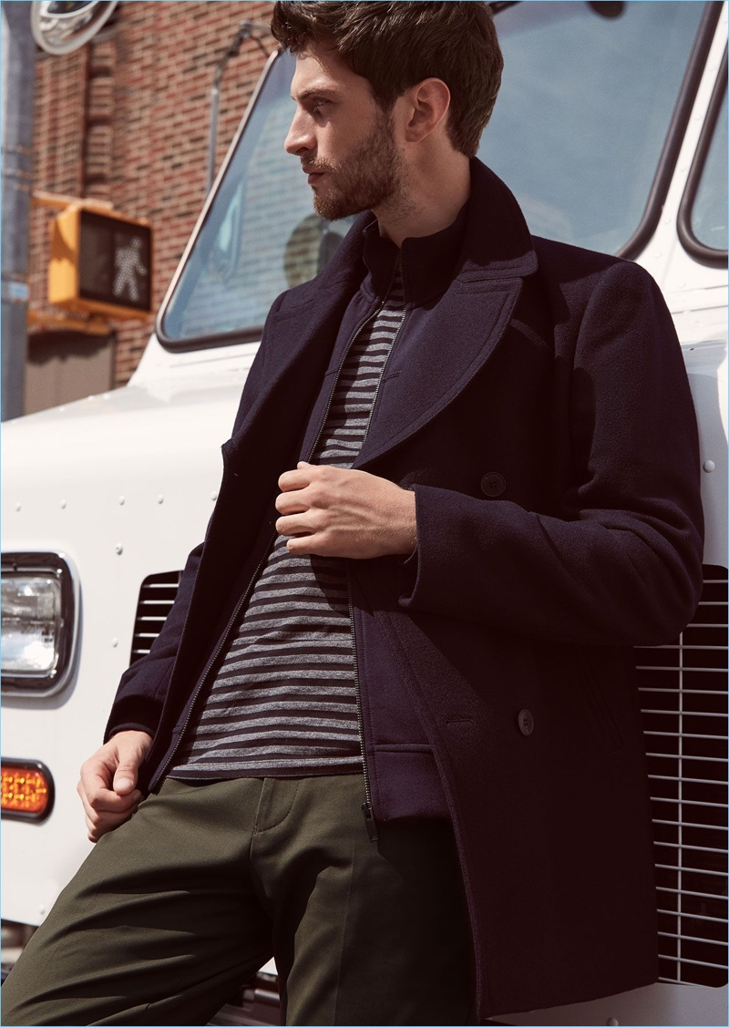 Fall in line with Reiss' wool-blend peacoat $540 in navy. Matthew Bell wears it with a stripe t-shirt $85, full-zip jumper $180, and slim-fit chinos $210.