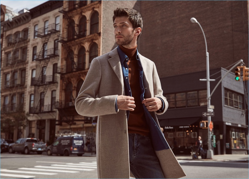 Freshen up your casual style with a sharp wool-blend overcoat $620 by Reiss. Here, it goes with a denim shirt $170, turtleneck sweater $170, and jeans $180.