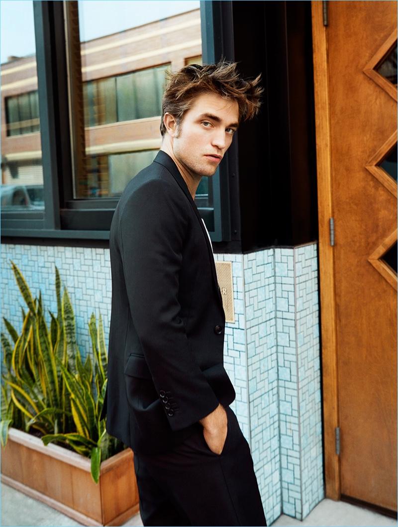 Stepping outdoors, Robert Pattinson wears Dior Homme.