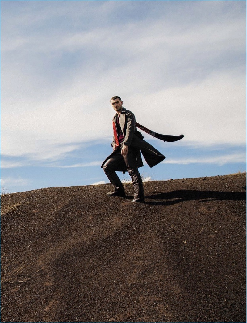 Taking to the outdoors, Sam Smith wears a Prada look with Saint Laurent boots.