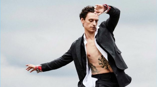 Striking a pose, Sergei Polunin dons a Salvatore Ferragamo suit with a J.W. Anderson shirt. Polunin layers with a Charvet shirt and wears Dries Van Noten shoes.