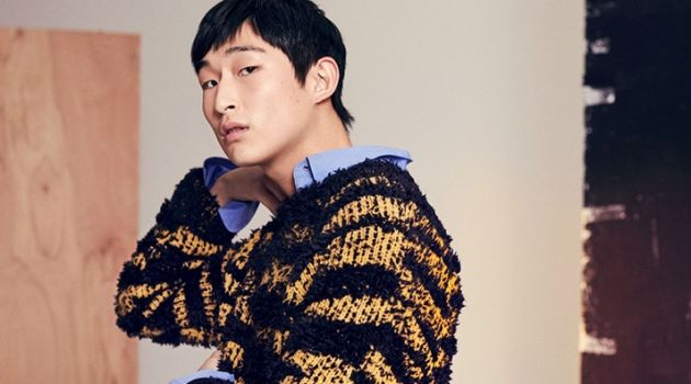 Making a texture play, Sang Woo Kim wears a Stella McCartney striped sweater and shirt.