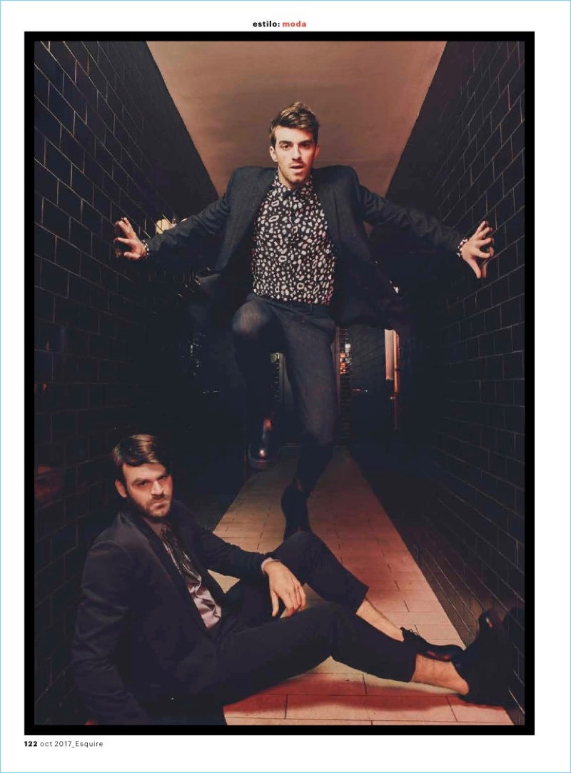 The Chainsmokers star in a new photo shoot. Alex wears a shirt and suit by Salvatore Ferragamo. He also sports Marcelo Burlon shoes. Meanwhile, Drew Taggart rocks a shirt and suit by AllSaints with Marcelo Burlon shoes.
