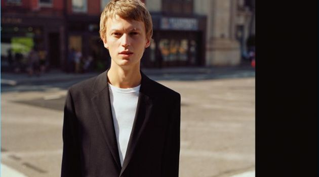 Taking to the streets of New York, Jonas Glöer wears a black Good Wool suit by Theory.