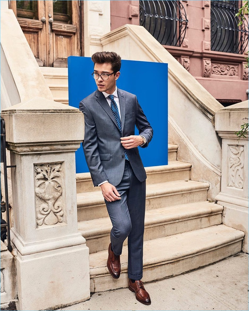 Wearing glasses and a suit, Francisco Lachowski appears in Vince Camuto's fall-winter 2017 campaign.